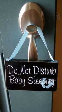 I thought this was cute and for the price. Do Not Disturb Baby Sleeping wood sign - door hanger. $10.00, via Etsy.
