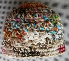 beanie - Scrap yarn with one cohesive strand through out.