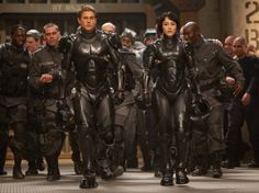 """Charlie Hunnam (front left) stars in """"Pacific Rim"""" -- science fiction film that gay men will want to see."""