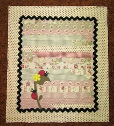Jelly Roll Baby Quilt with ladybug. Peace, Robert from nancysfabrics.com