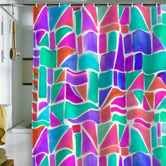 I really like this shower curtain! It's so colorful it's almost obnoxious but it looks so fun. (Aqua blue, mint, purple, pink, coral.)  [Amy Sia Watercolor Shapes Shower Curtain]