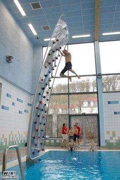 more exciting than a slide...pool rock climbing wall