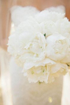 White peonies would look amazing with that Carolina Herrarra dress.