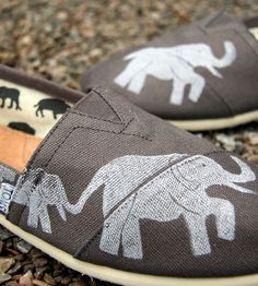 Grey Printed Toms Shoes - Elephant by The Matt Butler on Scoutmob Shoppe. These custom Toms shoes are crafted from grey canvas and feature a herd of elephants handprinted on the surface.