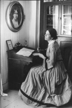 Louisa May Alcott at her writing desk in Orchard House.