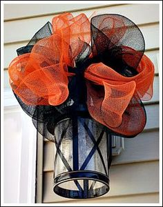 I really love mesh ribbon! It is so easy to make bows, and it last great in outside weather. Mesh ribbon is pretty inexpensive, and if you find it on sale- even better!