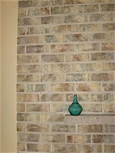 Brick Recoloring Service refinishes ugly brick. We refinish brick fireplaces and brick walls. Brick Staining and Painting.