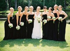 Black bridesmaids dresses make the bride's dress pop so nicely