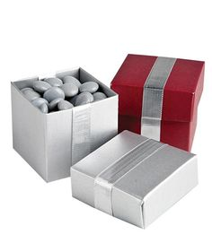 Such a cute wedding favor idea!  Red and silver boxes filled with custom M!