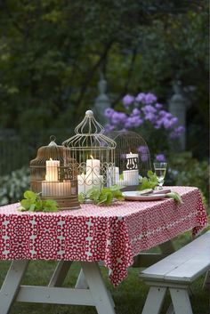 Love outdoor entertaing ~ love the birdcages & candles and the red tablecloth ~ From: Inspirations by D