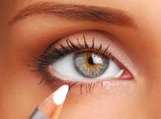 White eyeliner on the bottom makes eyes looks bigger. Add a light coat of mascara on the top and you're golden.