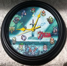 The Legend Of Zelda A Link to the Past Master Sword Wall Clock Round Classic 16 Bit. $15.00, via Etsy.