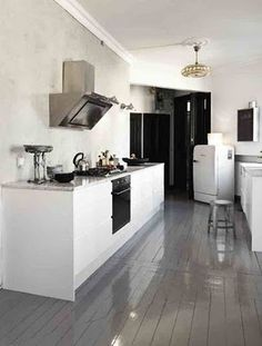 Grey gloss painted floorboards