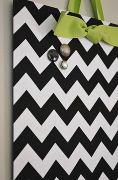 Get a flat cookie sheet and cover with fabric. Instant, cute magnet board