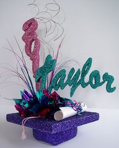 Graduation Table Centerpieces | Most use their school colors but as you can see are not limited to.