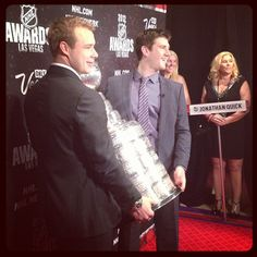 Quick and Brown at the NHL Awards with the Cup.