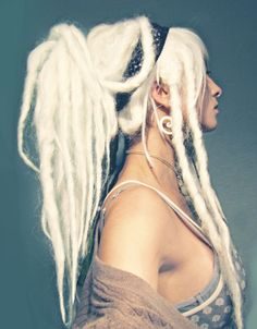 Bleached hair, and dreads with spiral earrings... she looks a little thin to me, very sharp features and a long elegant neck.