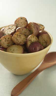 These Crispy Oven-baked Herbed New Potatoes are not only lower in fat than fried potatoes but also incredibly simple to make. #recipes #sides #easy