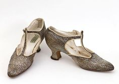 Silver/gold brocade evening shoes, c.1925. They close at ankle with fancy rhinestone buttons.