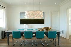 turquoise chairs and black dining room table