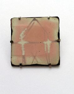 Map Pin 9/9 2012       Brooch: Sterling, torch fired sifted and white liquid enamel on copper, 1.75 x 1.75 inches