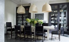 Antiques and Modern Pieces Mix in the Coolest London Home // black dining chairs, pendant lights