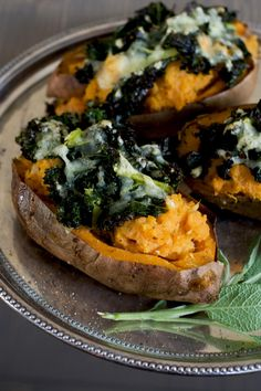 Loaded sweet potatoes with kale & cheese