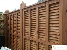 This is the inside view of a custom louvered style wood privacy fences.