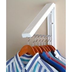 Arrow hanger space saver - folding clothes hanger for laundry closet under stairs