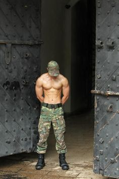 Hot guy in camouflage pants (he must be in the army or either he just loves to wear camouflage) showing us his sexy abs as he poses like a soldier who just lost one of his co-soldiers.