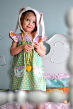 Adorable bunny girl! Love her giant necklace and mixed-up prints. Dress by LottieDaBaby.