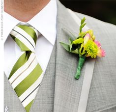 Love the grey suit and and green tie! And this boutonniere!