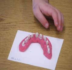 teeth...pink playdoh and white beans