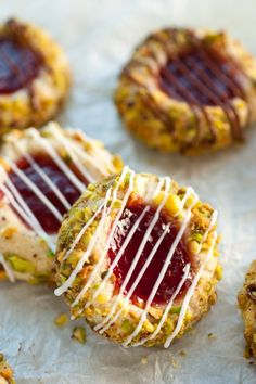 italian thumbprints - a thumbprint with strawberry jam, pistachios and chocolate. They are divine! italian cookie recipes, thumbprint cookies, italian recipes dessert, italian strawberri, white chocolate, italian cookies recipe, italian thumbprint, jam cookies, strawberri thumbprint
