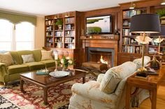 """Portfolio traditional living room,"" by Cynthia Mason Interiors -- Those bookcase lamps are showing up in a lot of library shelving."