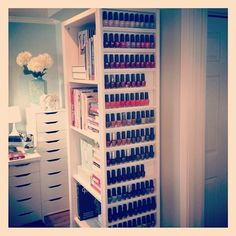 nail polish storage on the side of a bookshelf