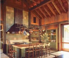 Stunning barn-themed kitchen in Napa with green cabinetry