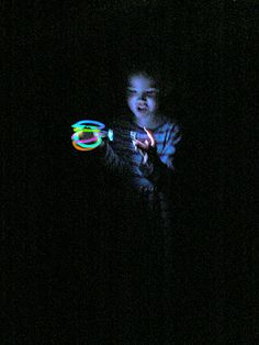 Backyard Glowstick Hunt (from blog, Having Fun At Home.) She hid glow bracelets in yard, gave kids flashinghts, and sent them on a hunt. What a fun summer's eve game!