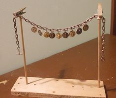 This chain holder is easy to make and can help with both jewelry making and jewelry photography. http://artbeadscene.blogspot.com/2008/01/i-love-tools-chain-holder.html