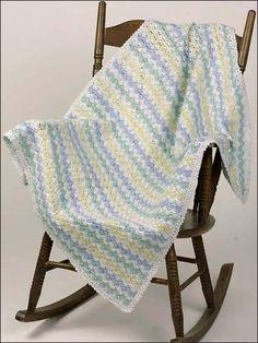 Free Zigzag Shells Baby Afghan Crochet Pattern --  Download this free crochet baby blanket pattern from Freepatterns.com.