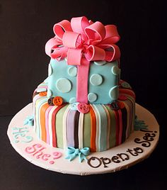 gender revealing party cake - just the top layer, no bow but I love the words around the bottom