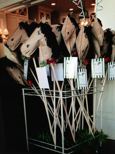 By far my loftiest party favor! I made 26 hand made, stuffed stick horses as take home gifts for Jack's 2nd birthday derby themed party.  They each had a garland of roses and a nametag featuring a previous Derby winner. Great for adult Derby party decoration, too. They were a big hit with the kids.