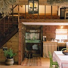 Small rustic house with kitchen under loft  I love the stairs.