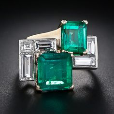 5.00 Carats Mid-Century Emerald and Diamond Ring. An artful Mondrian-esque grouping of geometrical shapes rendered in a pair of vibrant green Columbian emeralds: 3 carats   & 2 carats; five white baguette diamonds, together weighing 1.75 carats, vintage gemstone ring measures 13/16 inch side to side by 11/16 inch top to bottom in Platinum. Substantial, very.