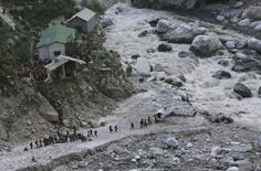 Soldiers assist survivors to board a rescue helicopter next to the River Alaknanda, during rescue operations in Govindghat in the Himalayan state of Uttarakhand June 22, 2013. Early monsoon rains have swollen the Ganges, India's longest river, swept away houses, killed at least 138 people and left tens of thousands stranded, local newspapers reported. REUTERS/Danish Siddiqui Posted by floodlist.com #floods #uttarakhand
