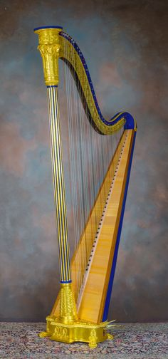 Erard single action ram's-head style harp, #604, from about 1819. Fully restored by H. Bryan & Co. 41 light gauge strings, intact swell doors. Offered for sale at $19,875.