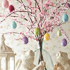 Turn your floral arrangement into a festive Easter tree with a few egg ornaments.