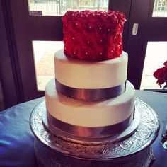 Wedding cake round three tiers white butter cream with grey ribbon and red rosettes. Texas tech wedding.