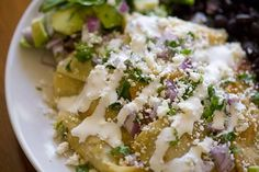 chilaquiles - fried corn tortillas, green sauce, topped with black beans, eggs and avocado - forgot the cilantro and cotija cheese - yummy!