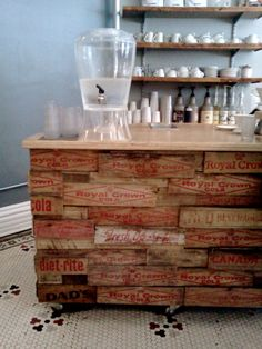 Recycled soda crates used as bar decor for the cafe's front counter.